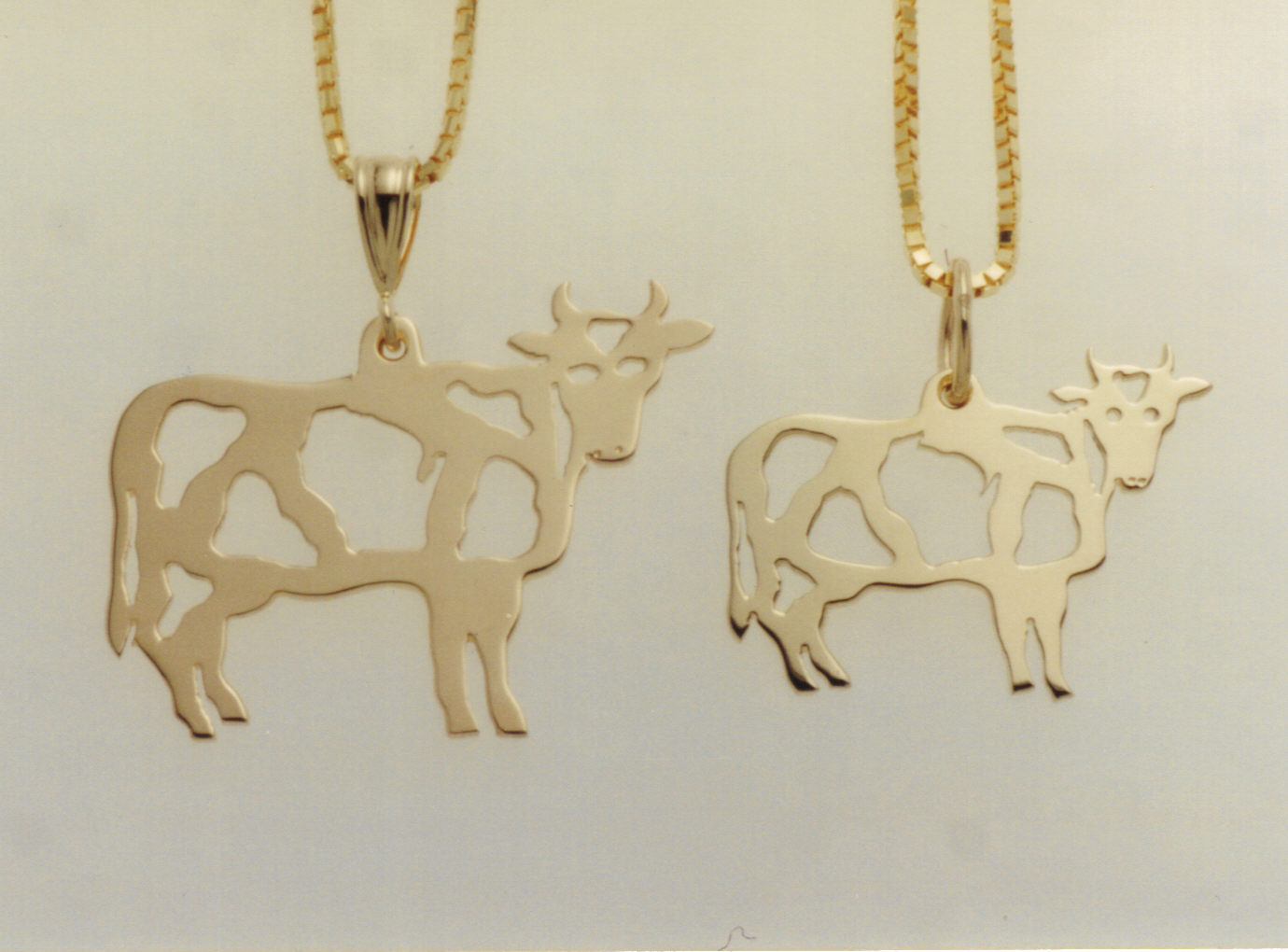 Wis-cow-sin Cow Pendant and Charm in 14K yellow gold